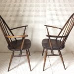 A Pair of Dark Wood Ercol Carver Chairs
