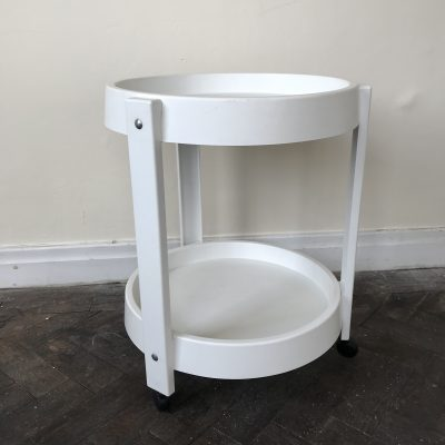 White plastic drinks trolley
