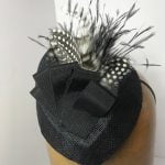 Black sinamay fascinator with petersham and feathers