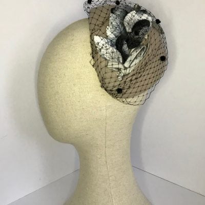 Grey wool half-hat with velvet leaves and spot veiling