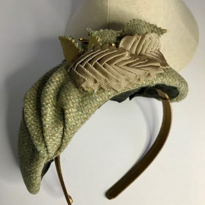 Olive herringbone tweed half-hat with flowers and ribbon detailing