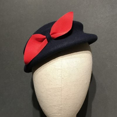Eva – a 1950s style tilt hat in navy wool felt with red bow