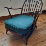 Ercol 203 Arm Chair Complete with cushions.
