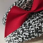 Eva – a 1950s style tilt hat in black and white Toyo straw and wide petersham bow
